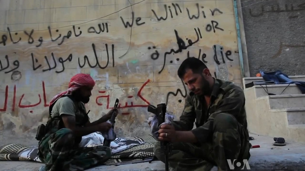 FSA rebels cleaning their AK47s in Aleppo, Syria during the civil war (19 October 2012). (VOA News/Wikimedia Commons)