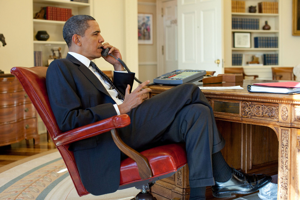 President Barack Obama talks on the phone. Jan. 15, 2010 (Pete Souza/Wikimedia Commons)