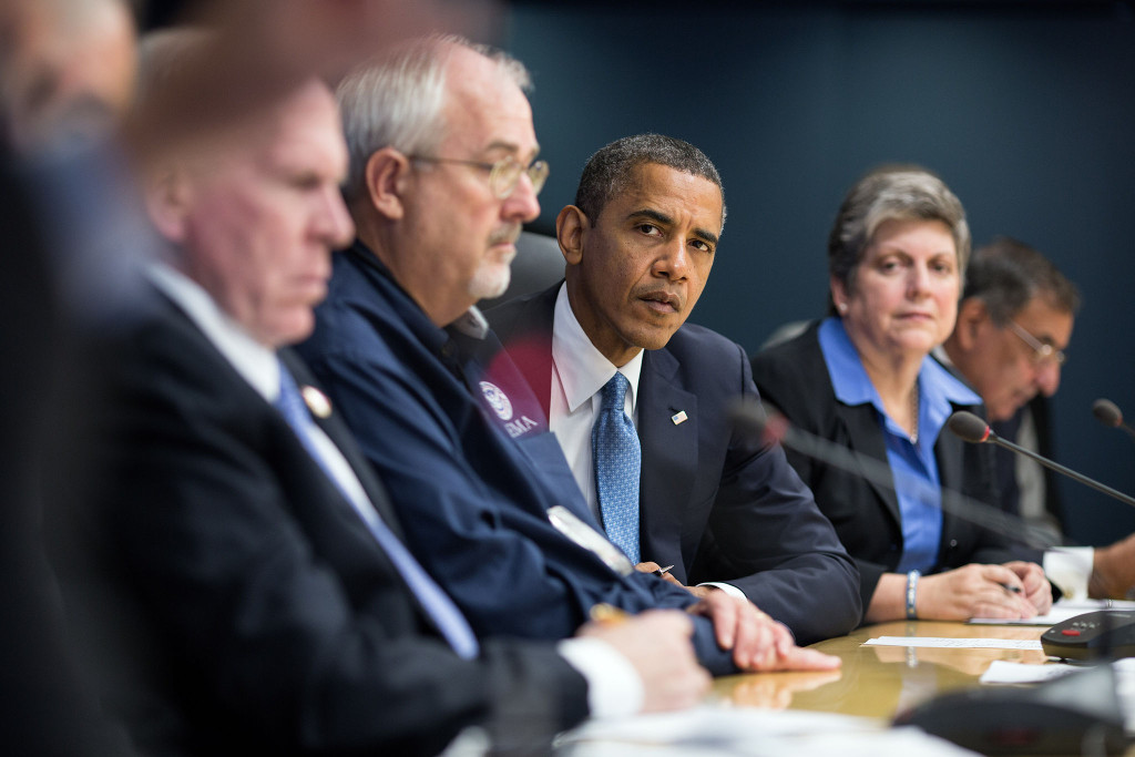 United States President Barack Obama listens to Transportation Secretary Ray LaHood speak during a briefing on the response to Hurricane Sandy at FEMA headquarters in Washington, D.C. October 31, 2012 (Pete Souza/Wikimedia Commons)