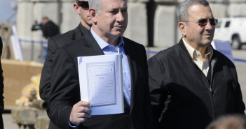 Prime Minister Benjamin Netanyahu and Defense Minister, Ehud Barak hold an Iranian instruction manual for the C-704 anti-ship missile. March 16, 2011. (Israel Defense Forces/Flickr Creative Commons)