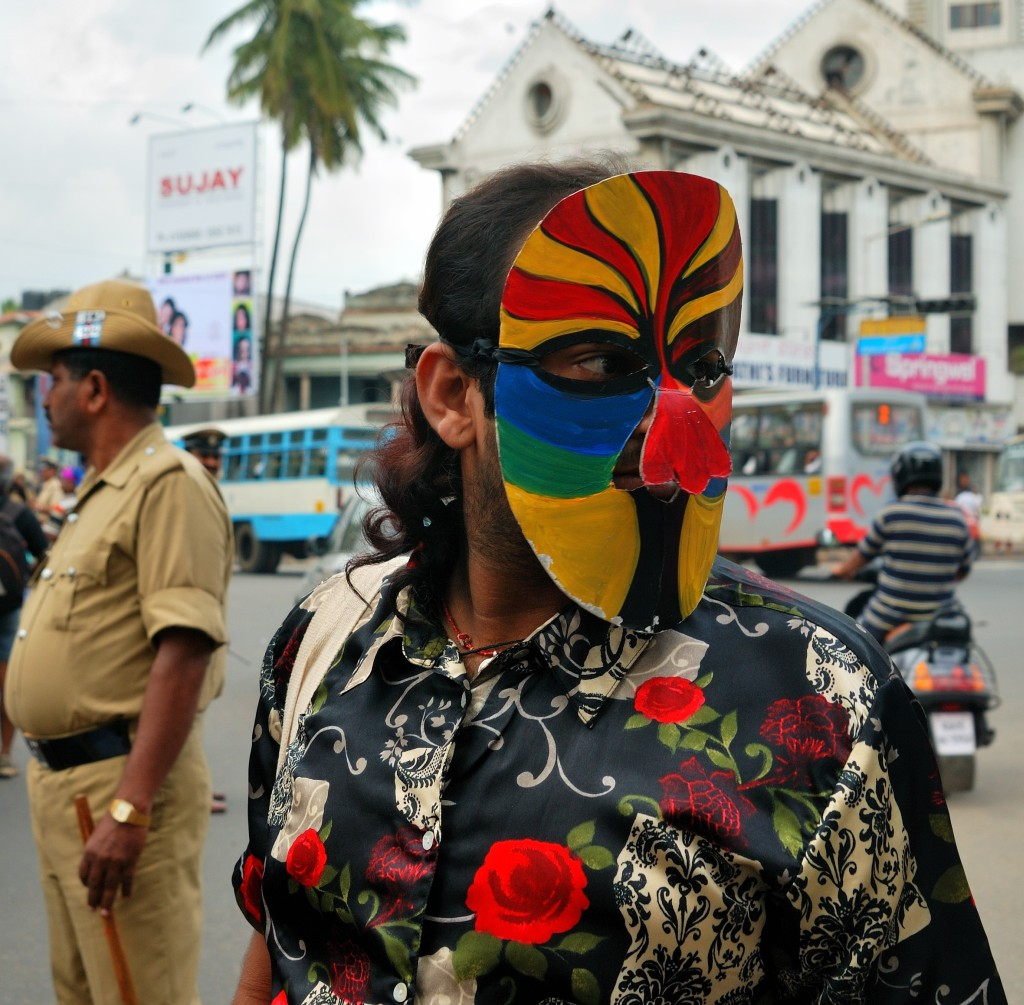 A 2009 LGBT activist and an Indian police officer stare in opposite directions during a march for LGBT rights in Bengaluru. (Vinayak Das/Creative Commons)