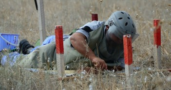 A man working with the United Nations Development Program attempts removing a landmine in Fizuli, Azerbaijan. May 2, 2014 (United Nations Development Program/Creative Commons).