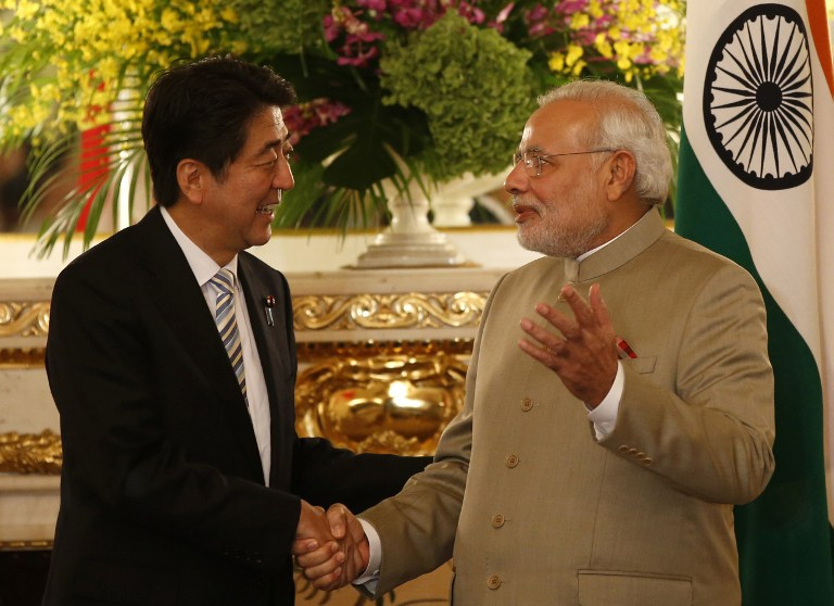 India's Prime Minister, Narendra Modi (right), and Japan's Prime Minister, Shinzo Abe, shake hands before their talks at the state guesthouse in Tokyo. 2014. (Scroll Editorial/Flickr Creative Commons)