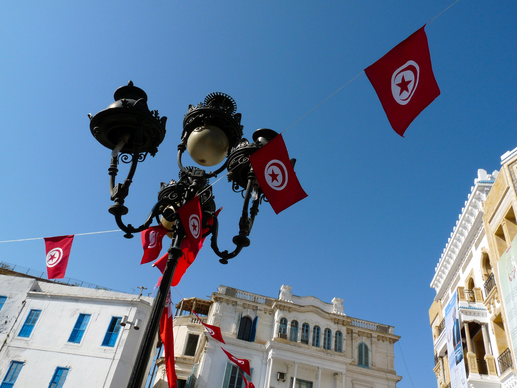 Tunisian flags strung up in city squares to help inspire citizens to vote in the first round of democratic elections held after the uprising. Now, after a few missteps on the path to democracy, Tunisia is about to try again this month. 2011. (Stefan de Vries/Flickr Creative Commons).