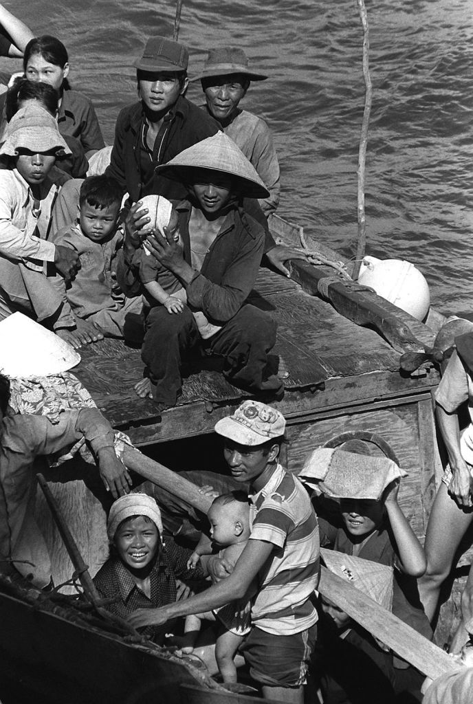 Refugees from Vietnam escaped on small and crowded fishing boats. May 1984. (Lt. Carl R. Begy/Wikimedia Commons)