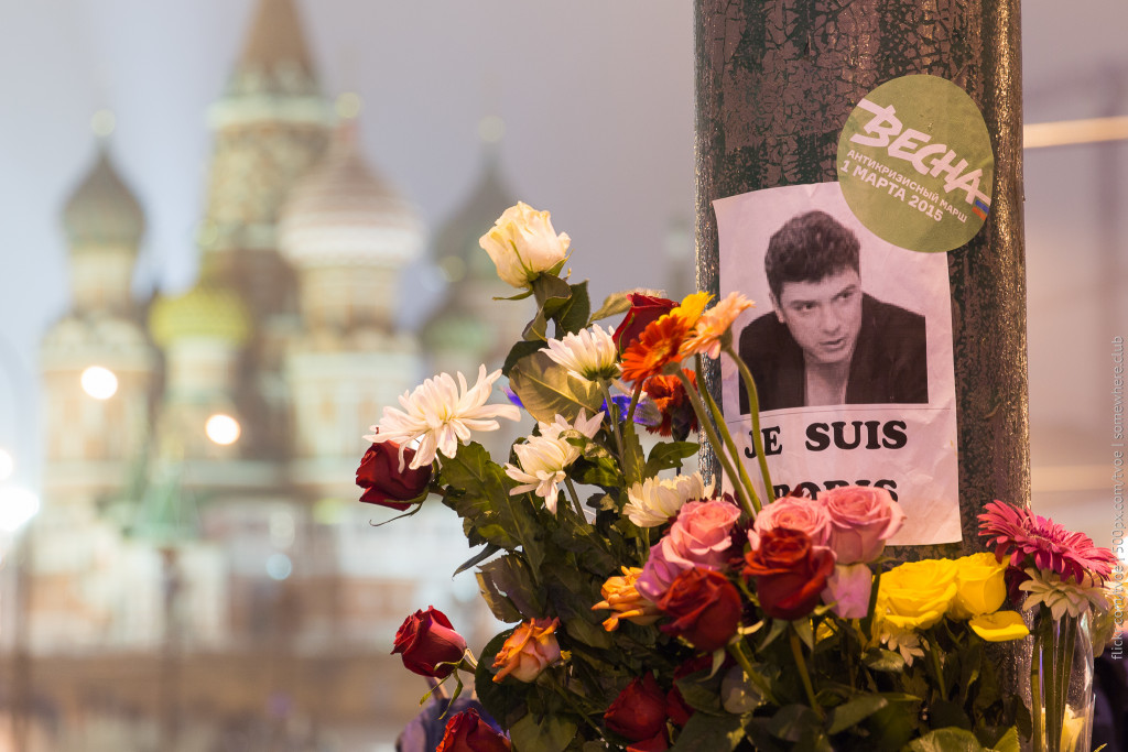 A small memorial for Boris Nemtsov, killed at 55 in sight of the Kremlin at the end of February. St. Basil's Cathedral is visible in the background. February 28, 2015. (Jay/Creative Commons)