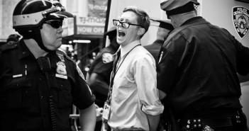 Journalist John Knefel is arrested by the NYPD during an Occupy Wall Street protest in 2012. (Glenn Halog, Flickr Creative Commons).