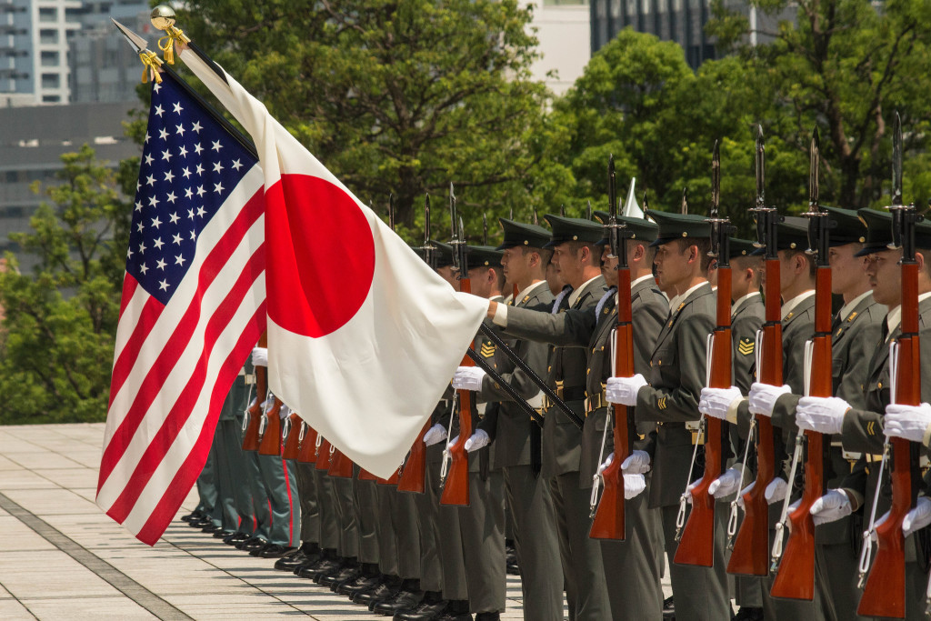 Japanese Ground Defense Force troops greet new commander of US Army forces in Japan in a ceremony at Yokota Air Base. July 2015. (Sgt. John L. Carkeet IV, U.S. Army Japan / Flickr Commons)