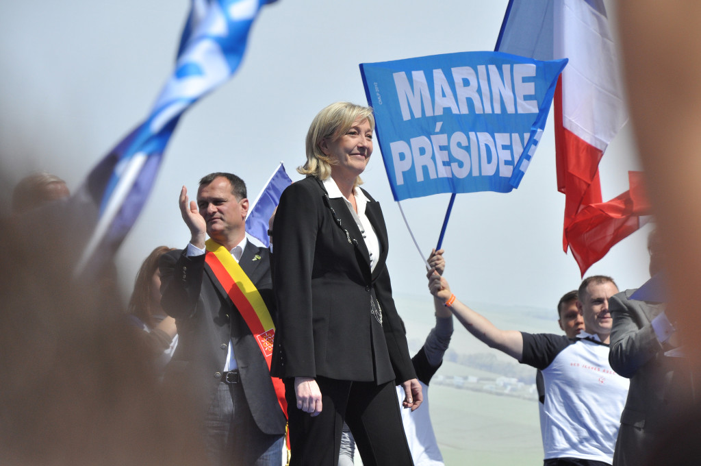 A fan expresses his support for Le Pen's bid for presidency at a 2012 Front National meeting. (Blandine Le Cain/Flickr)