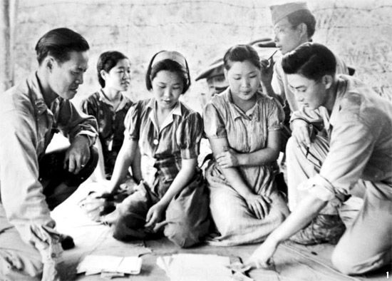 "Three Korean ""comfort women"" found and freed by American soldiers in Burma, August 14, 1944. (US Army/ Wikimedia Commons 2014)."