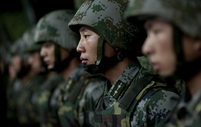 Chinese soldiers prepare for a military demonstration in July 2011. (Times Asi/Flickr CC).