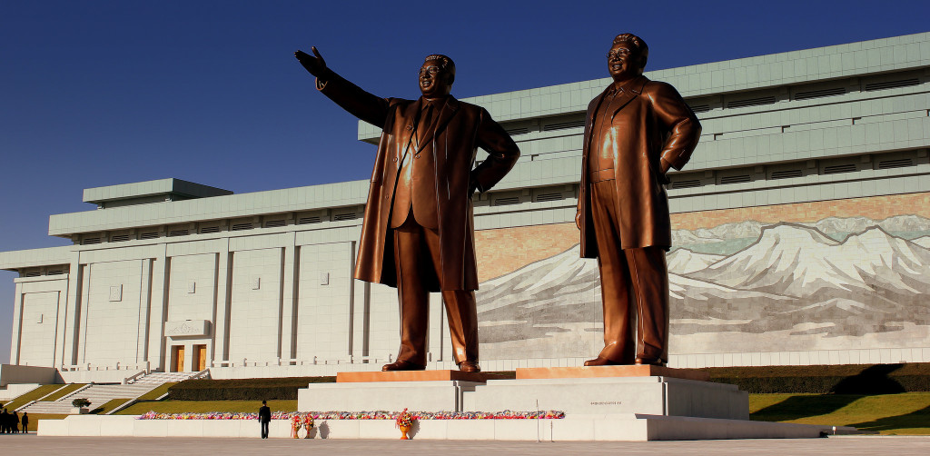 Caption: The bronze, 22-foot tall statutes of Kim Il-sung and Kim Jong-il in Pyongyang. October 23, 2012. (calflier001/Flickr)