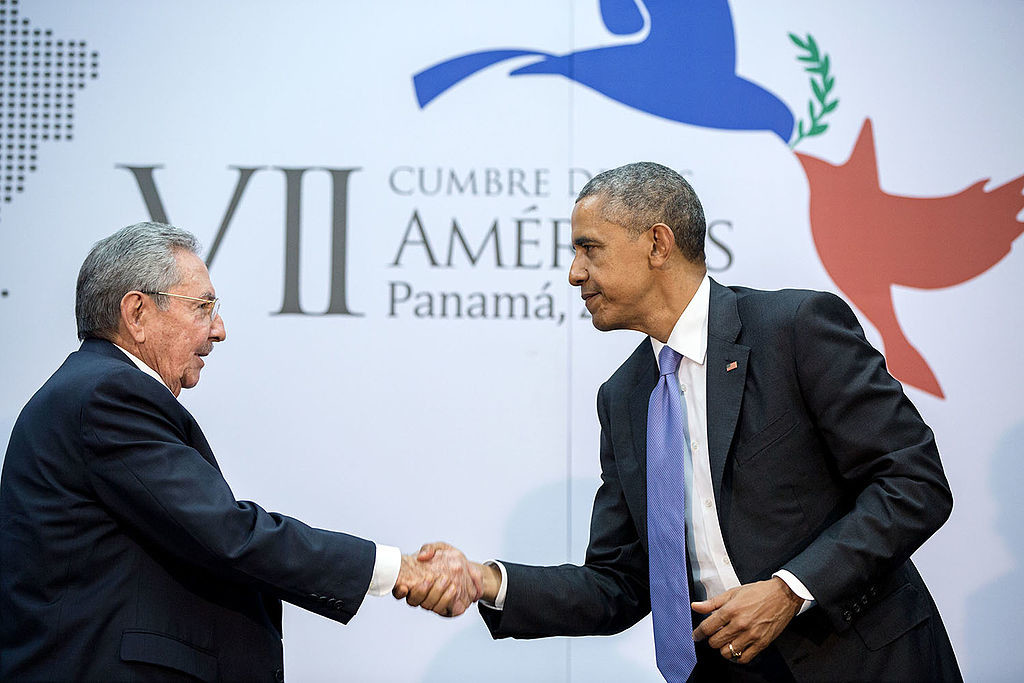 Caption: President Barack Obama and President Raúl Castro shake hands at the 7th Summit of the Americas. 2015. (Pete Souza/Wikimedia Commons)