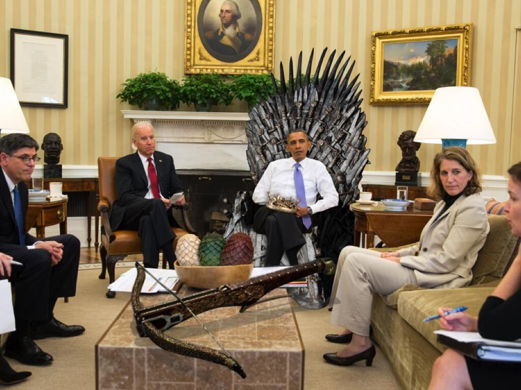 President Obama meets with other government officials in the Oval Office, edited to appear as if he is sitting on the Iron Throne from Game of Thrones. May 4, 2014. (Unidentified White House Staff/Wikimedia Commons)