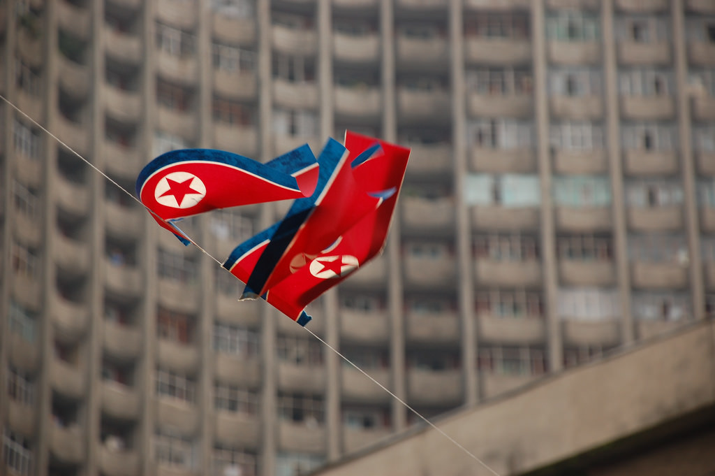 The North Korean flag flying over the nation's capital. (Stephan, North Korea – Pyongyang/Flickr Commons).