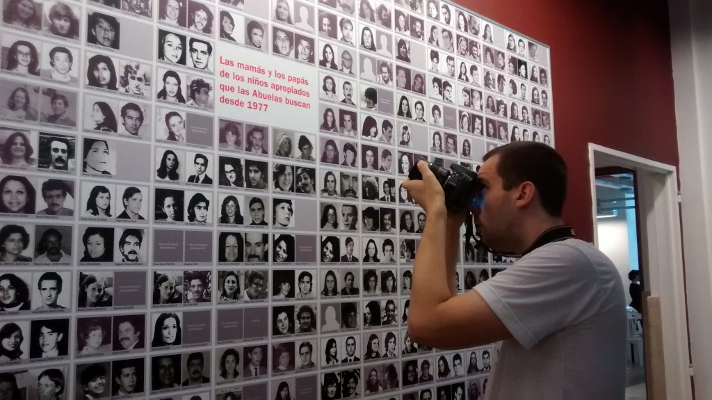 "A man photographs a list of Argentine ""desaparecidos"" (Wikimedia Commons)"