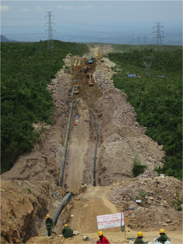An hour outside of Mandalay in upper Burma (Myanmar), construction of the Sino-Burma pipeline tears through the thick jungle. The pipeline is a joint venture between China National Petroleum Corporation (CNPC) and Myanmar Oil and Gas Enterprises (MOGE) and is designed to ease China's dependence on oil/gas transfers through the Strait of Malacca. (Photo Credit: Reid Lidow, All Rights Reserved 2012).