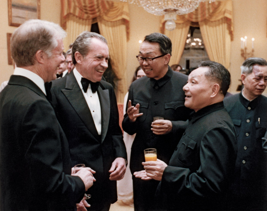 """Jimmy Carter and Richard Nixon confer with Chinese Vice Premier Deng Xiaoping in January 1979, nine years after Nixon's first visit to China and six years before the """"Year of the Spy"""" scandal. (Wikimedia Commons)"""