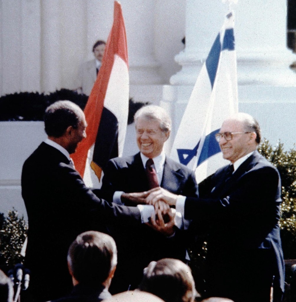 Menachem Begin, Jimmy Carter and Anwar Sadat triple-shake hands in 1979 to symbolize the first partnership between Israel, Egypt and the US. Today, is that relationship only getting stronger, and if so, why now? (Government Press Office/Wikimedia Commons)