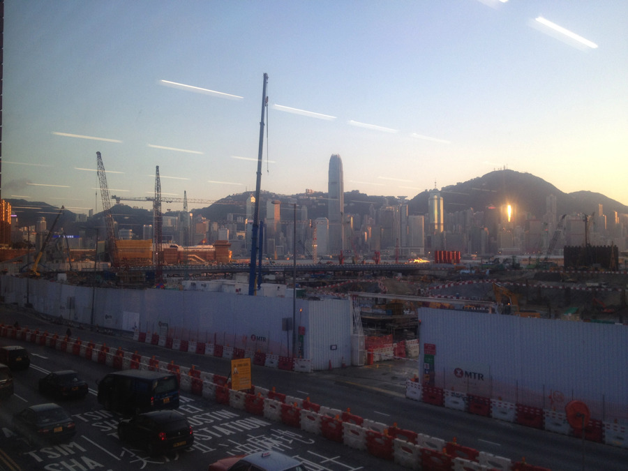 The Kowloon Station under construction, with a view of Hong Kong's famous skyline and Victoria Peak in the background. August 14, 2012. (Author's Photo)