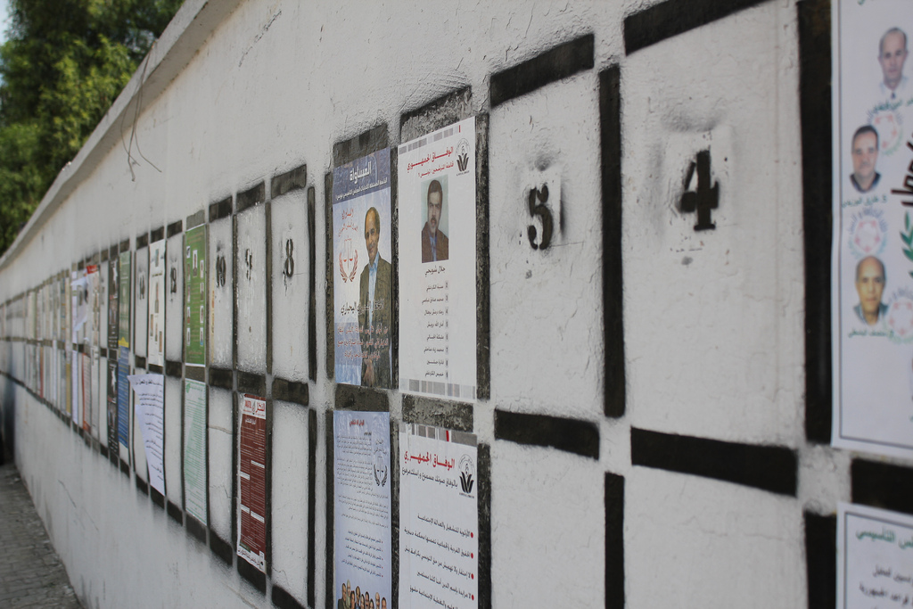 Tunisian voting lists lining the walls of the streets of Tunis during the 2011 elections. Similar preparations are underway now for the elections in late October. 2011. (Tarek/Flickr Creative Commons).