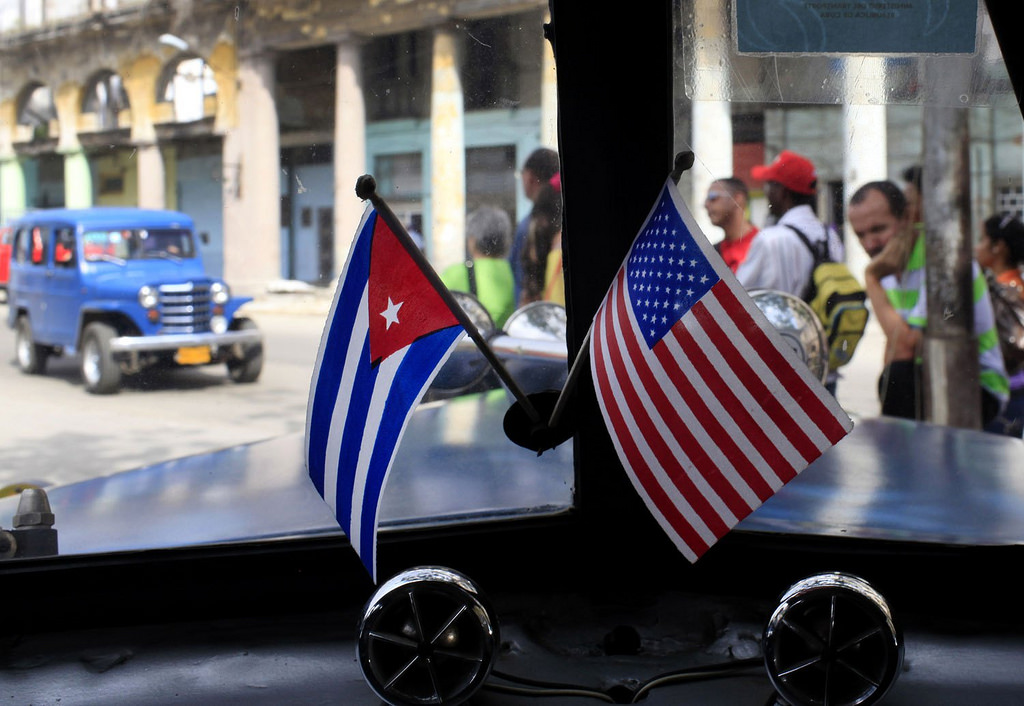 US and Cuban flags displayed inside a car in Cuba. December 17, 2014. (Day Donaldson/Flickr Creative Commons)