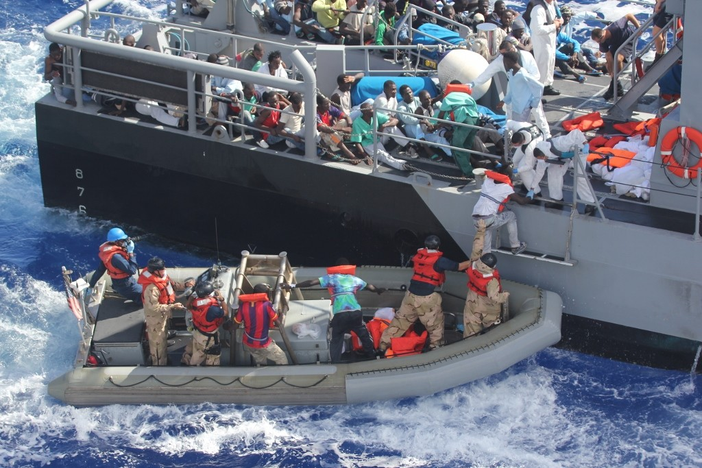 Distressed refugees rescued and transferred to Maltese patrol vessel. October 17, 2013. (Wikimedia Commons/US Navy)