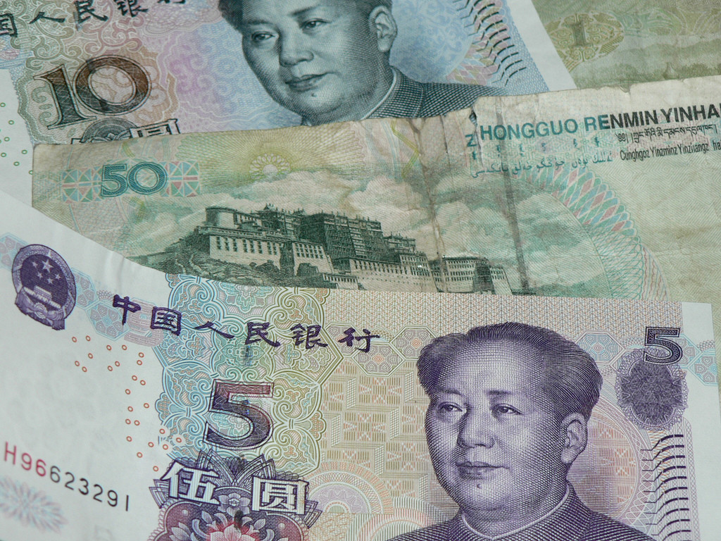 A picture of the Chinese 5, 10 and 50 yuan bills. On average (over the past 5 years), 1 US dollar has equaled between 6 and 7 Chinese yuan. (Christina B. Castro/ Flickr Creative Commons).