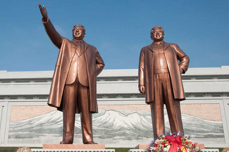 Caption: Mansudae Grand Monument located in Pyongyang, North Korea, depicts North Korea founder Kim Il-sung (left) and his successor, Kim Jong-il (right). 2012. (Romain75020 / Wikimedia Commons).