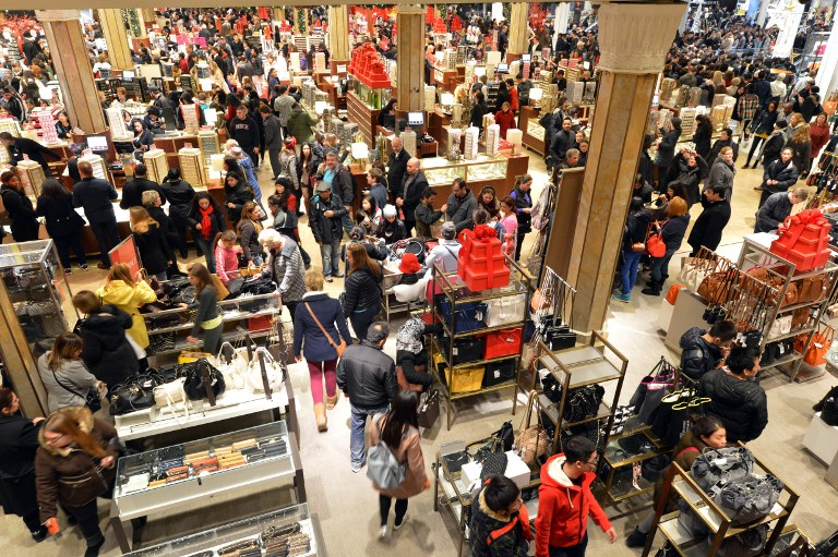 Shoppers flood Macy's department store in New York on Black Friday, eager to score a bargain on new clothing. (Diariocritico de Venezuela/Flickr), 2012.