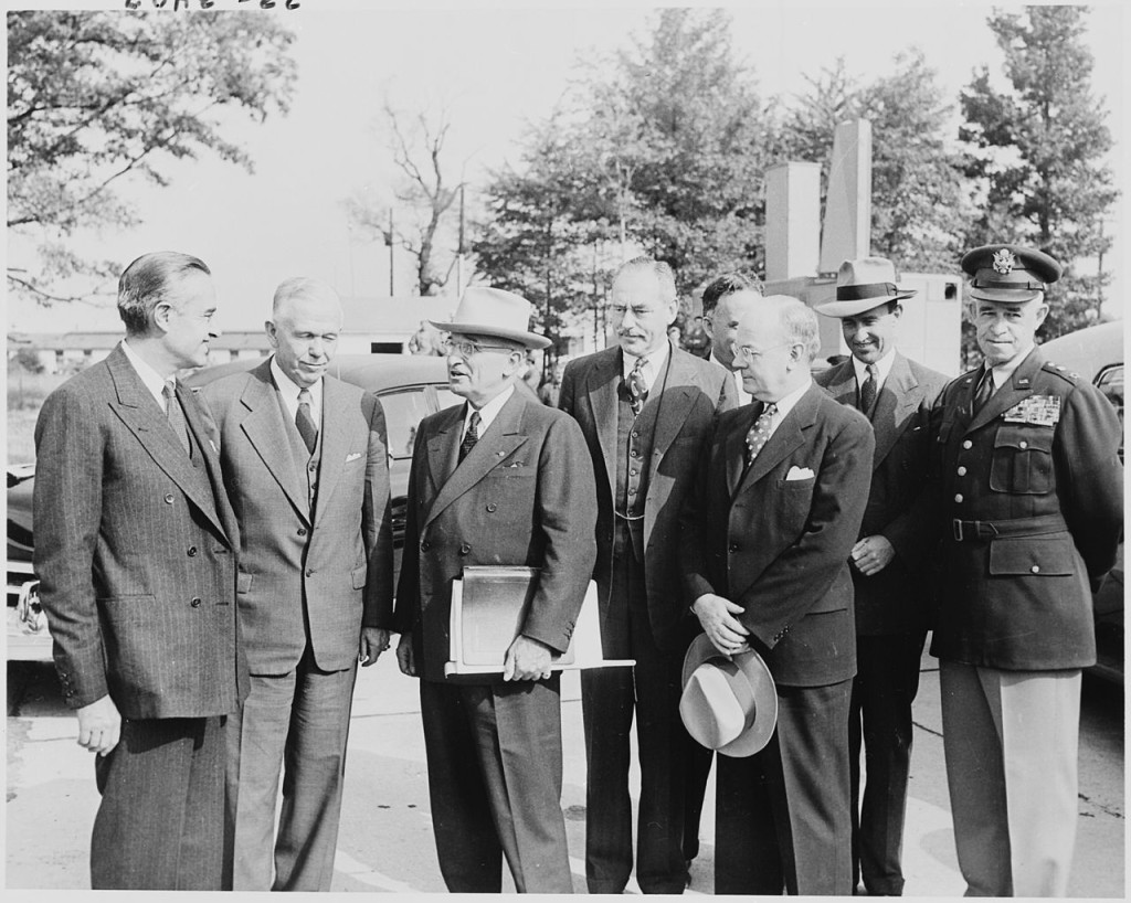 Truman with Achenson and other advisers (Wikimedia Commons).