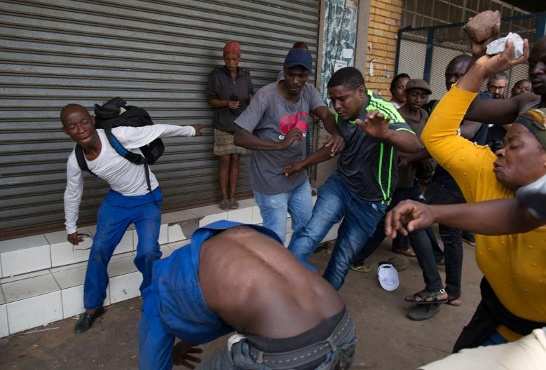 A Nigerian man is attacked in Pretoria in February 2017 (James Oatway/Reuters)